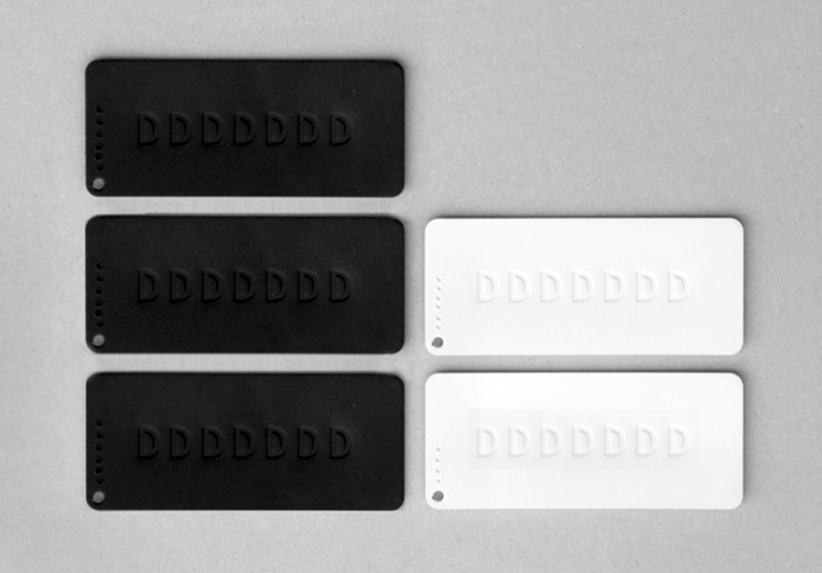 Blind embossed tags created by Demian Conrad Design for Swiss contemporary furniture design and manufacturer Dadadum