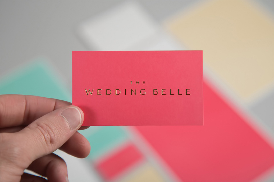 Logo and business cards with a pastel board and gold foil print finish designed by Ghost for wedding planner The Wedding Belle
