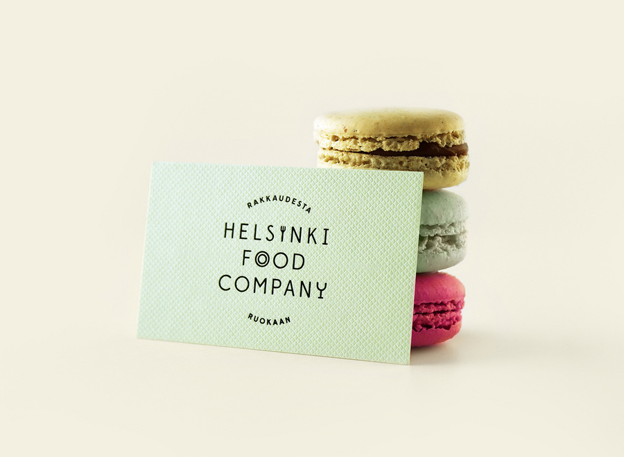 Logo and business card with an embossed surface detail for Helsinki Food Company designed by Werklig