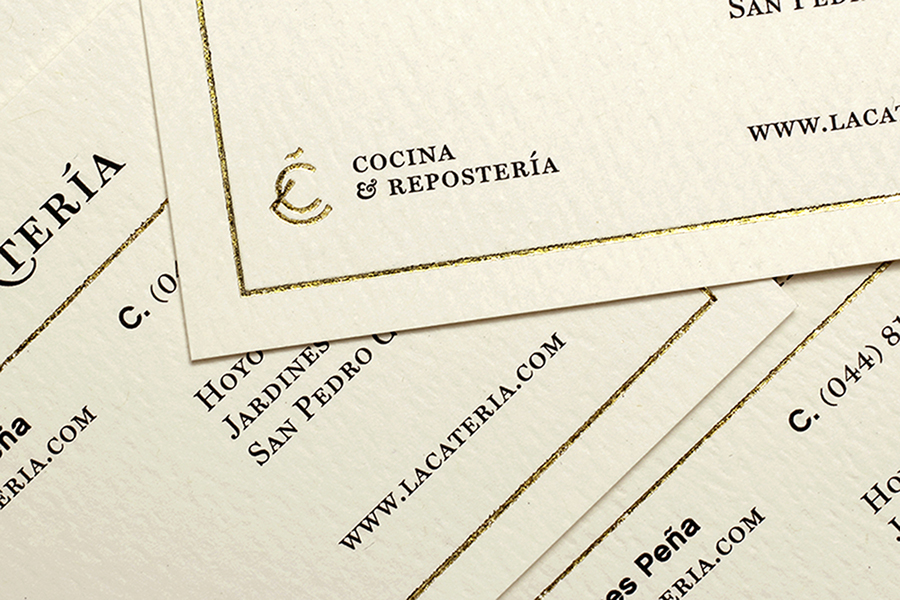 Monogram and business card with gold foil print finish designed by Firmalt for San Pedro catering business La Catería