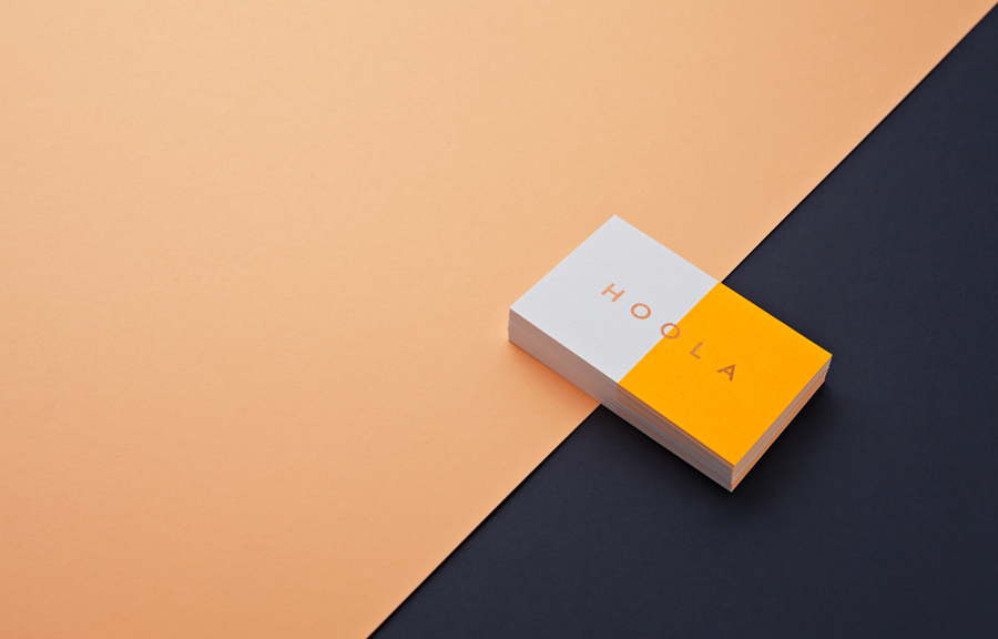 Logotype and business card with fluorescent ink and bronze foil designed by Two Times Elliott for women's swimwear brand Hoola