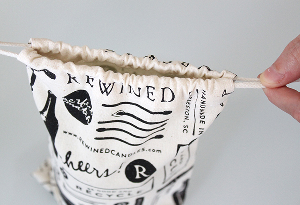 Packaging with illustrative detail including cloth bags designed by Stitch for craft candle brand Rewined
