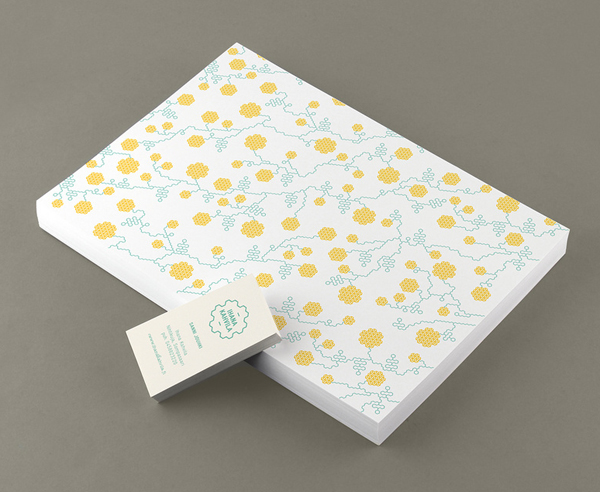 Logo and stationery with geometric floral illustrative detail designed by Werklig for freight container coffee shop Ihana Kahvila