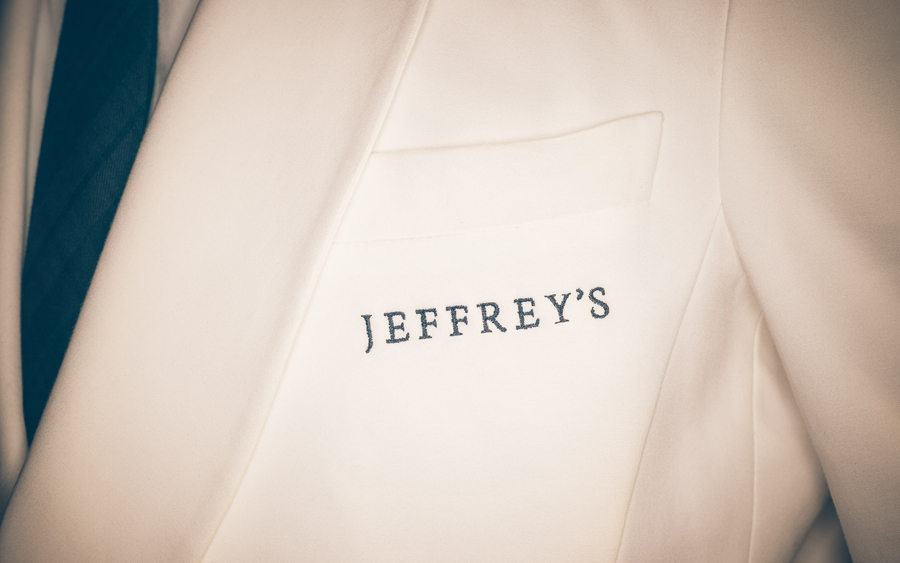 Logotype as a stitched uniform detail by FÖDA Studio for Jeffrey's
