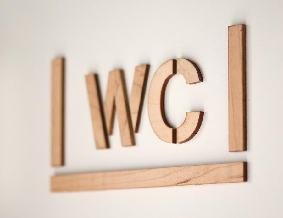 Wood cut signage designed by Mayuscula for Spanish organic supermarket Obbio