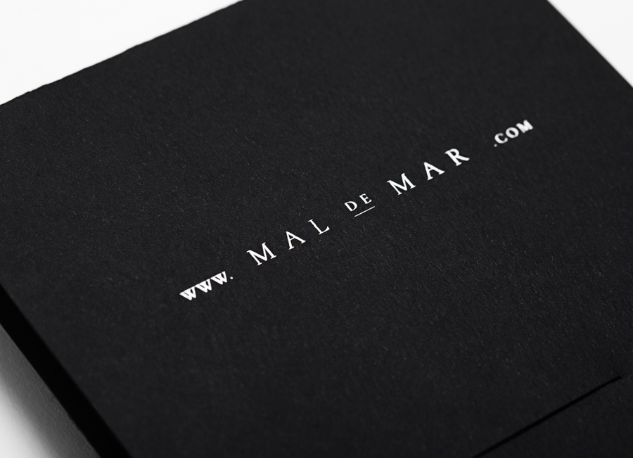 Logo and white foil folder for on-line art, design, architecture and photography journal Mal de Mar designed by Face
