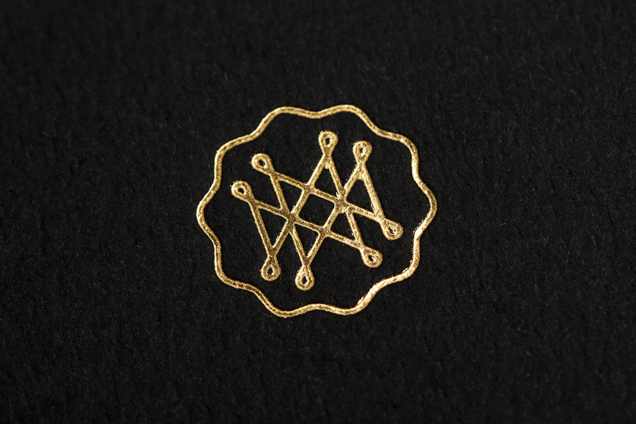 Logo as a gold foil detail for on-line art, design, architecture and photography journal Mal de Mar designed by Face