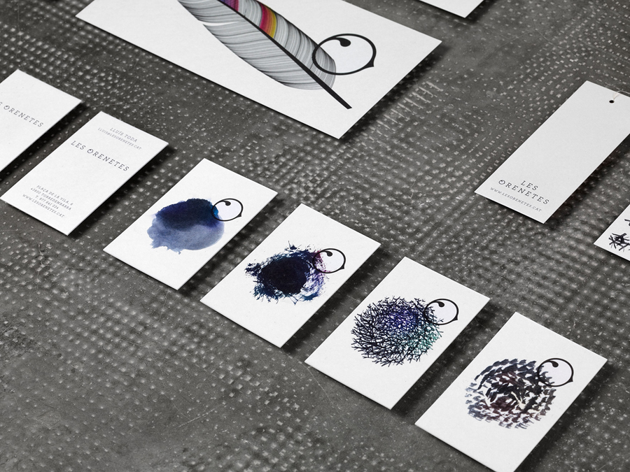 Logo, tags and business card with watercolour detail designed by Mucho for Spanish fashion boutique Les Orenetes