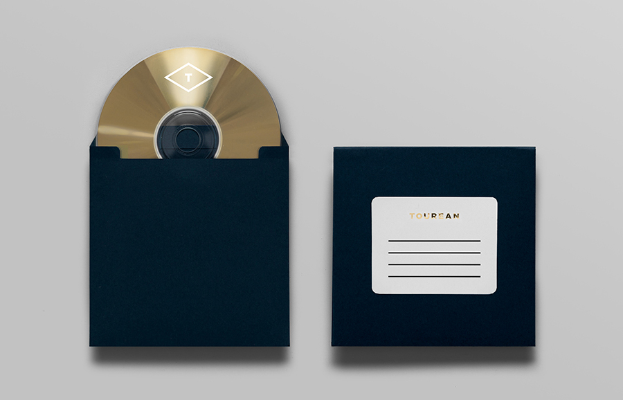 Logo and CD case with gold foil detail designed for British multinational venture capital firm Tourean by Anagrama