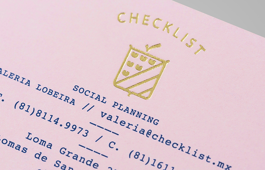 Logo as a gold block foil detail across a pink pastel paper designed by Anagrama for event panner Checklist