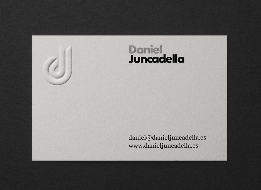 Logo and blind embossed business card with silver spot colour detail for Daniel Juncadella designed by Mucho