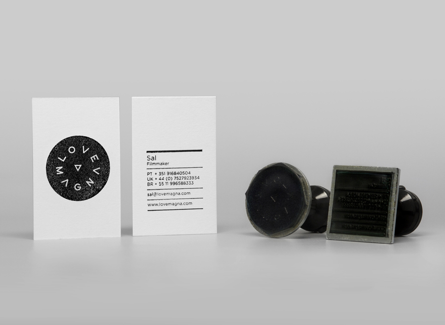 Logo and business card with stamp and emboss detail for production studio Love Magna designed by Musa WorkLabs