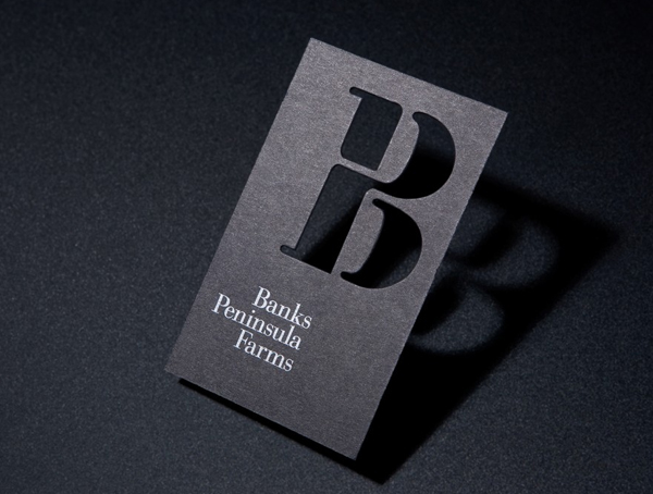 Logo and black die cut business card with white foil designed by Strategy for Banks Peninsula Farms