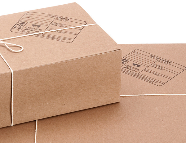 String tied uncoated unbleached boxes with stamp detail created by Glasfurd & Walker for delicatessen The Dirty Apron