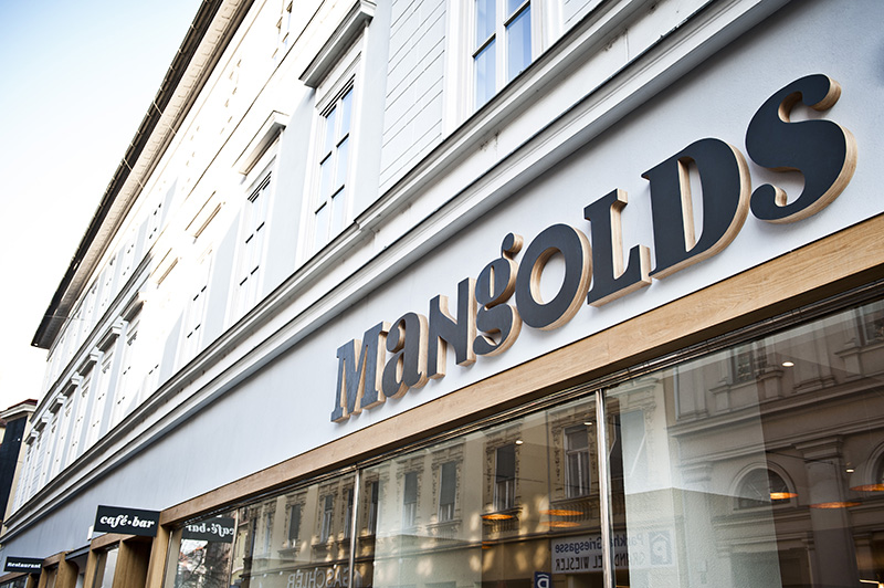 Logotype and exterior signage created by Moodley for Austrian vegetarian and wholefood restaurant Mangolds