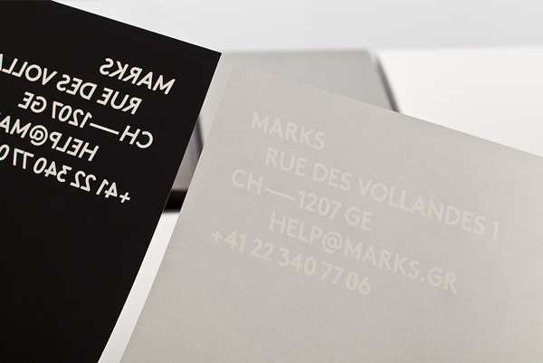 Logo and business cards with white foil detail designed by Marks
