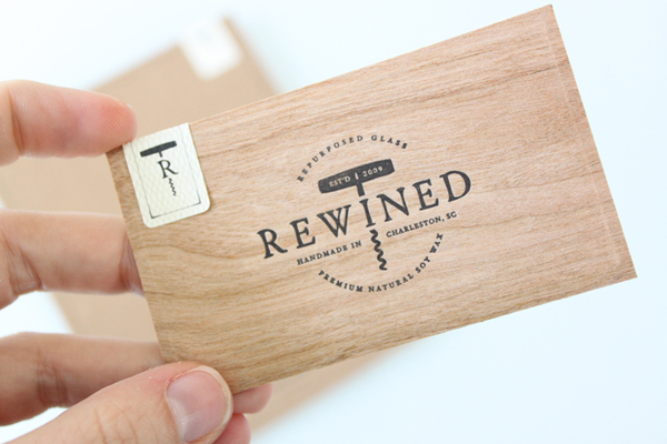 Logo and wood veneer and unbleached paper business card with sticker detail for candle in a wine bottle brand Rewined designed by Stitch