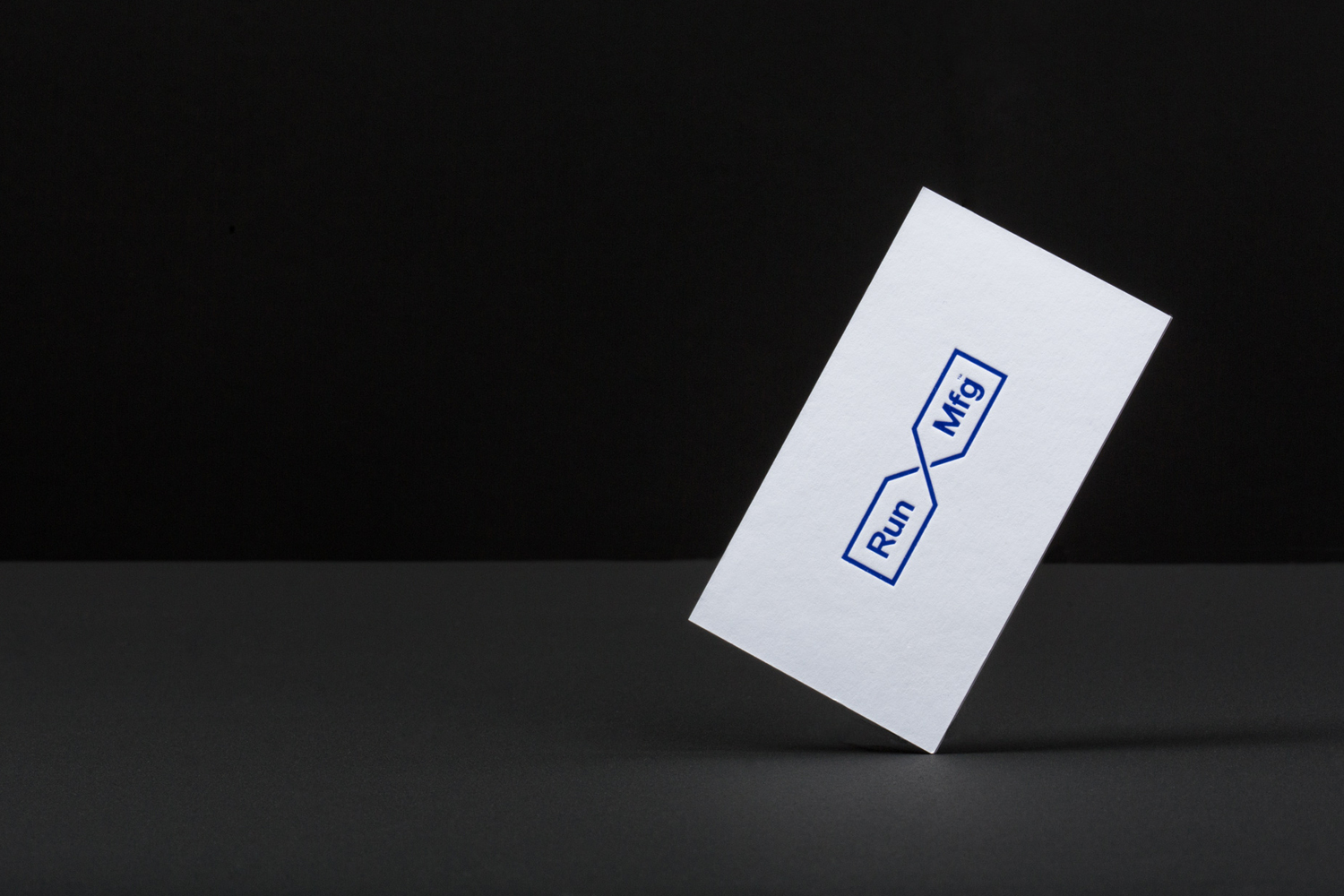 Logo and business cards by Perky Bros for Chicago-based independent race design and production company Run Mfg