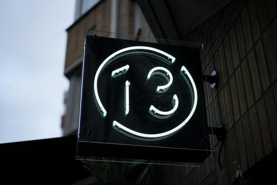 Logo and neon signage for Malmö restaurant Bord 13 by Swedish graphic design studio Snask