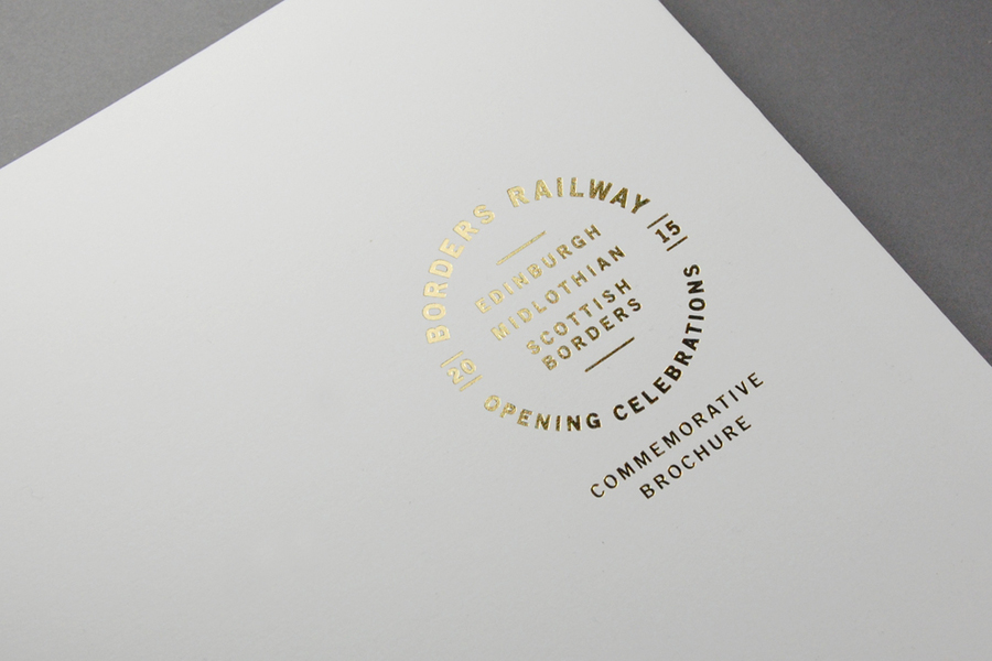 Commemorative brochure with gold block foil print finish for Borders Railway Opening Celebration by Glasgow based graphic design studio KVGD