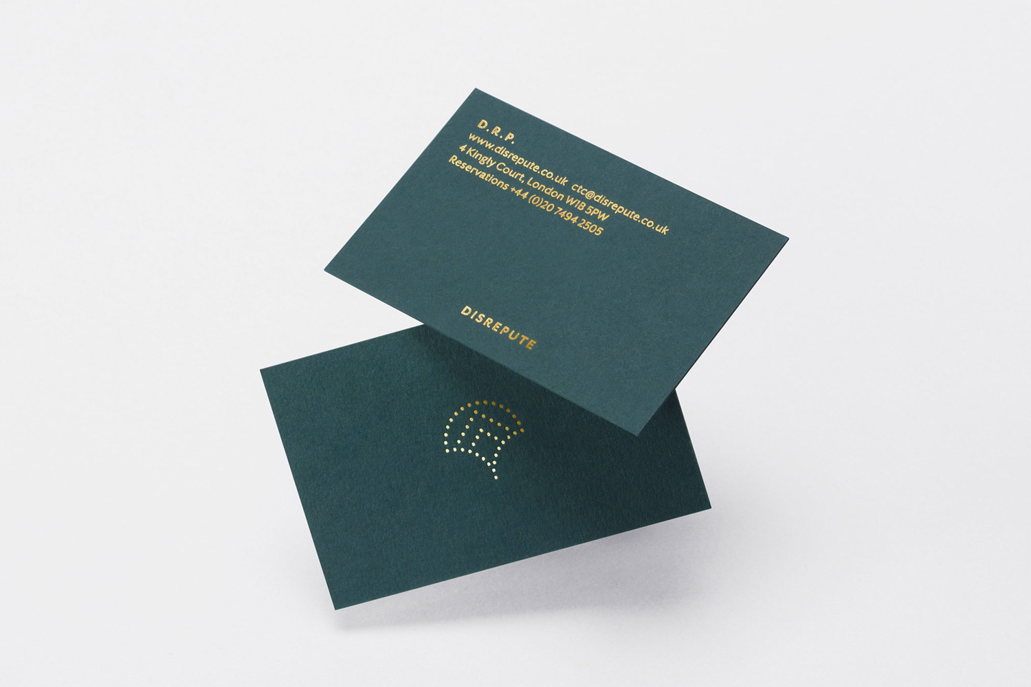 Brand identity and business cards with gold block foil detail by London-based studio Two Times Elliott for Soho members bar Disrepute