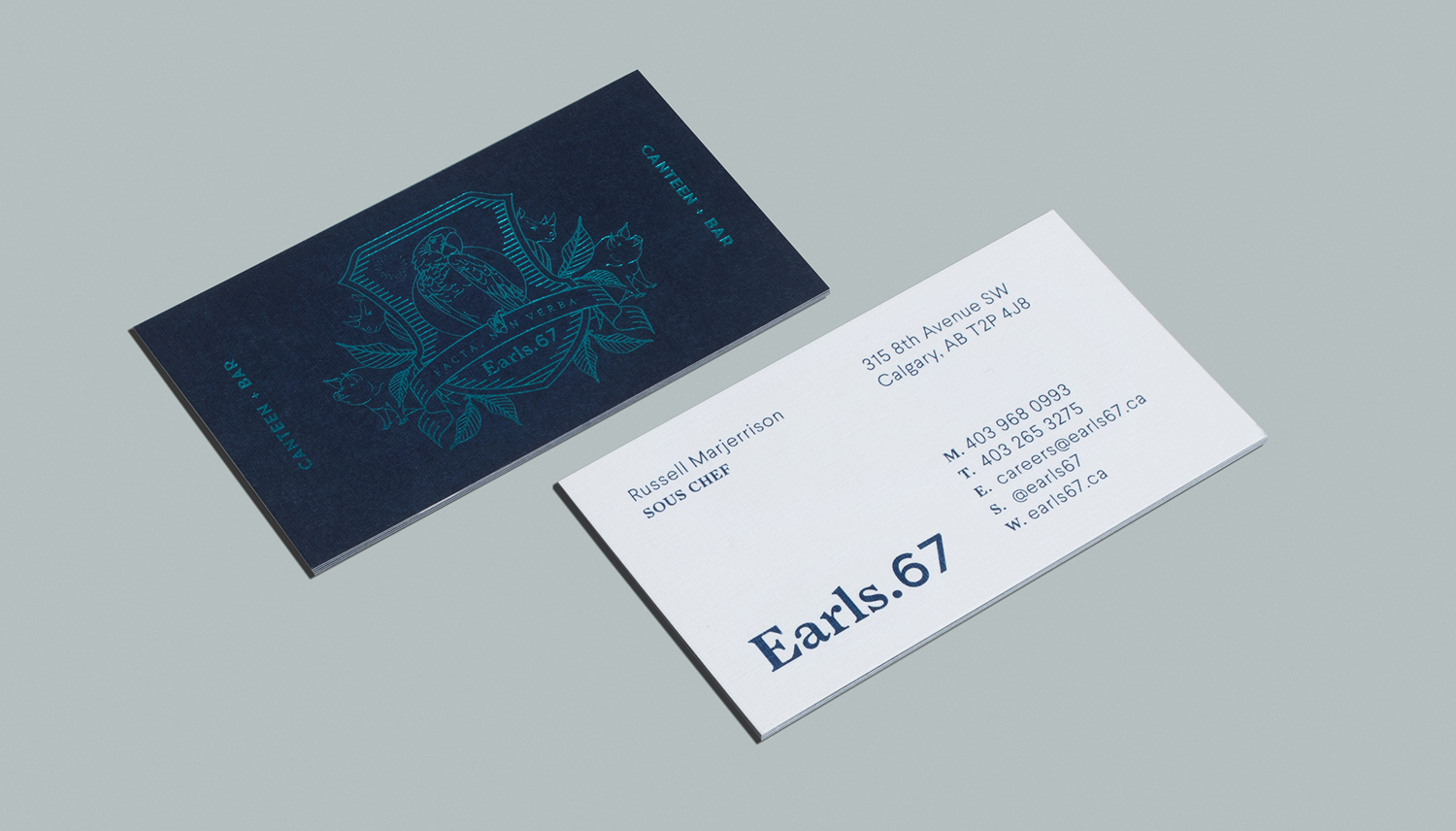Brand identity and business cards with blue block foil print finish by Glasfurd & Walker for US and Canadian restaurant chain prototype Earls.67