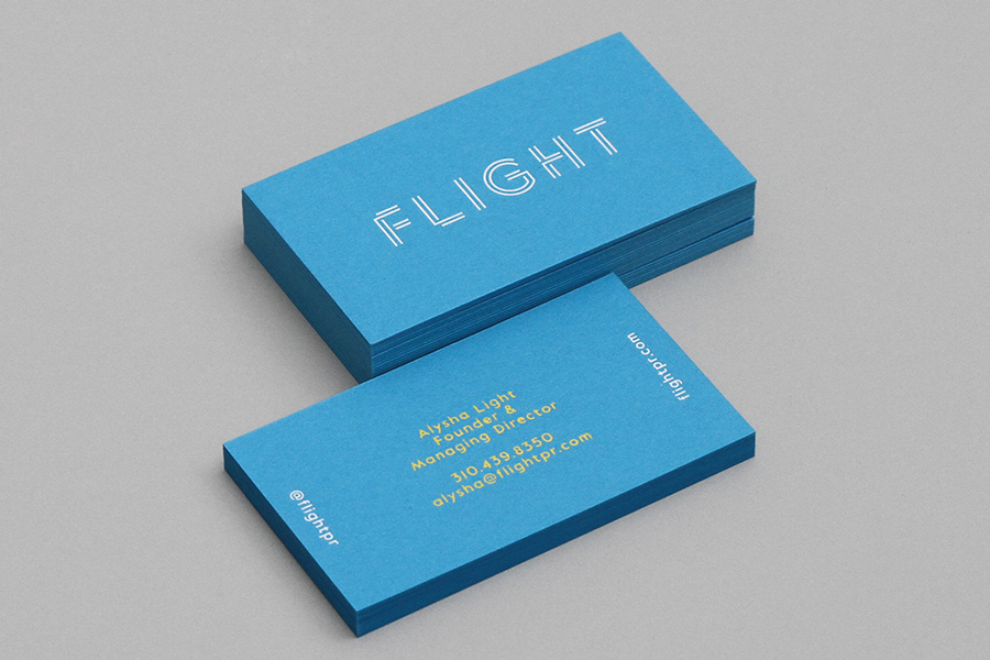Logo and coloured business cards with block foil detail by New York graphic design studio DIA for LA based public relations business Flight