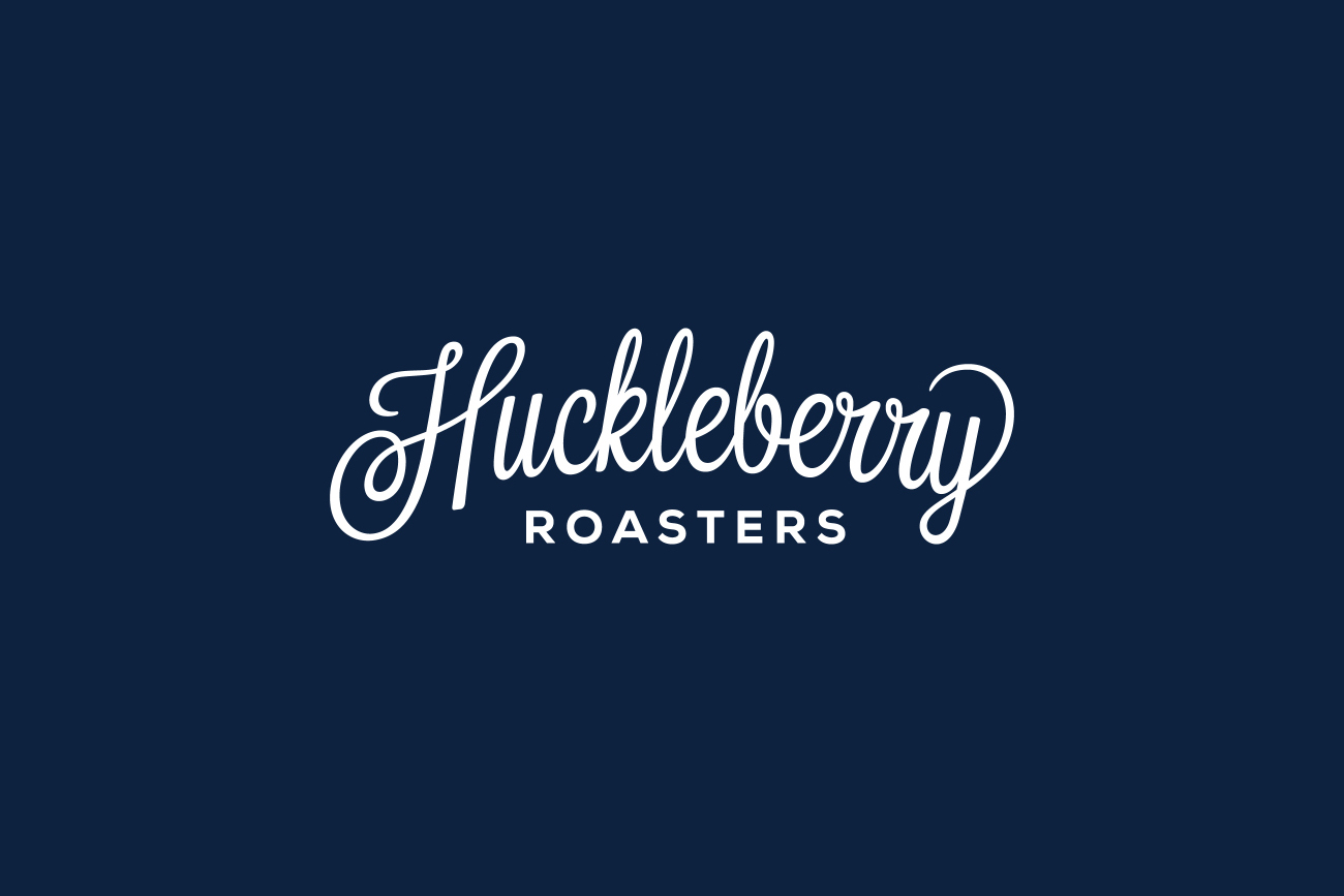 Hand drawn script logotype for Colorado coffee roaster Huckleberry by Mackey Saturday