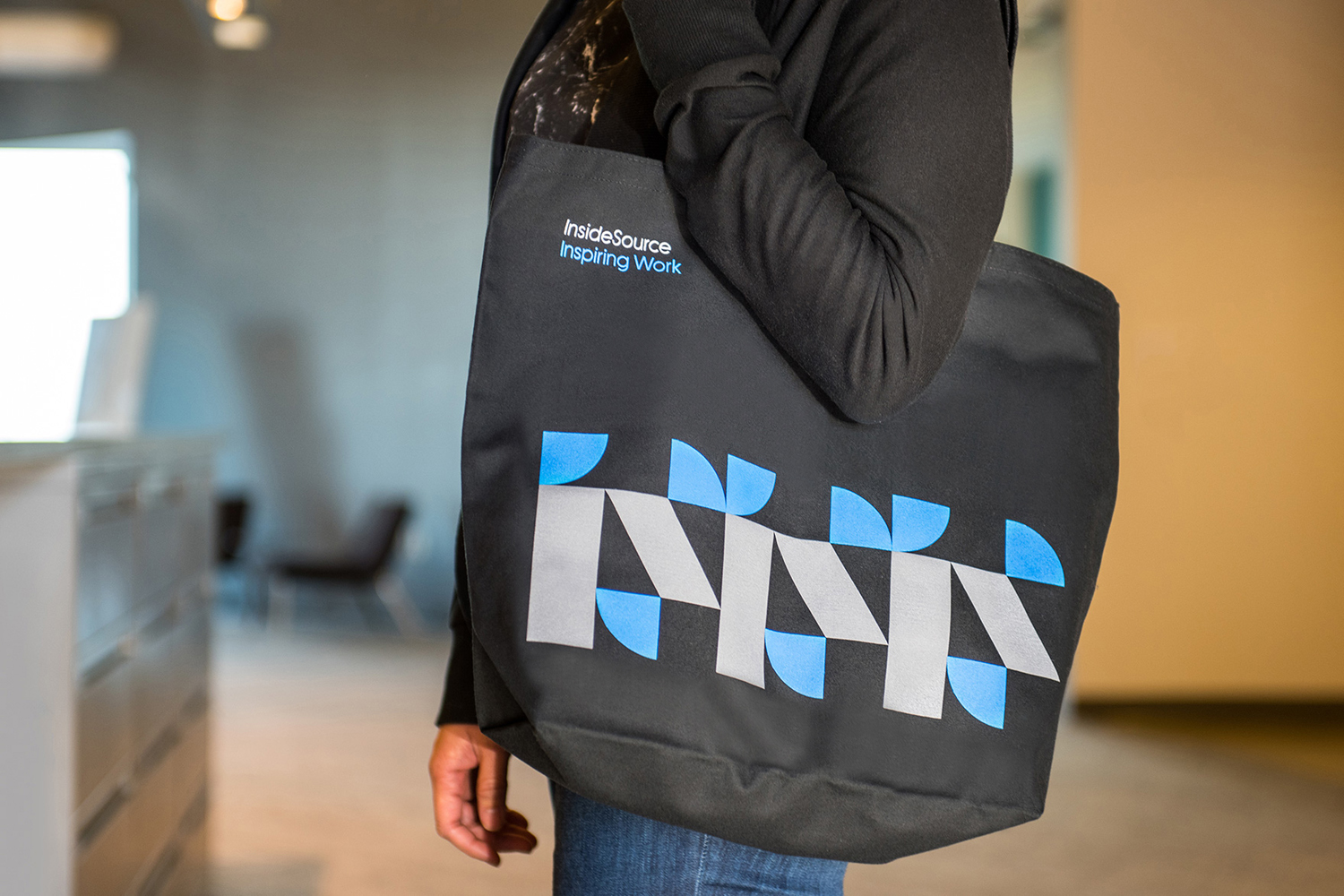 Brand identity and branded tote bag by Mucho for office space planning, design and project management company Inside Source