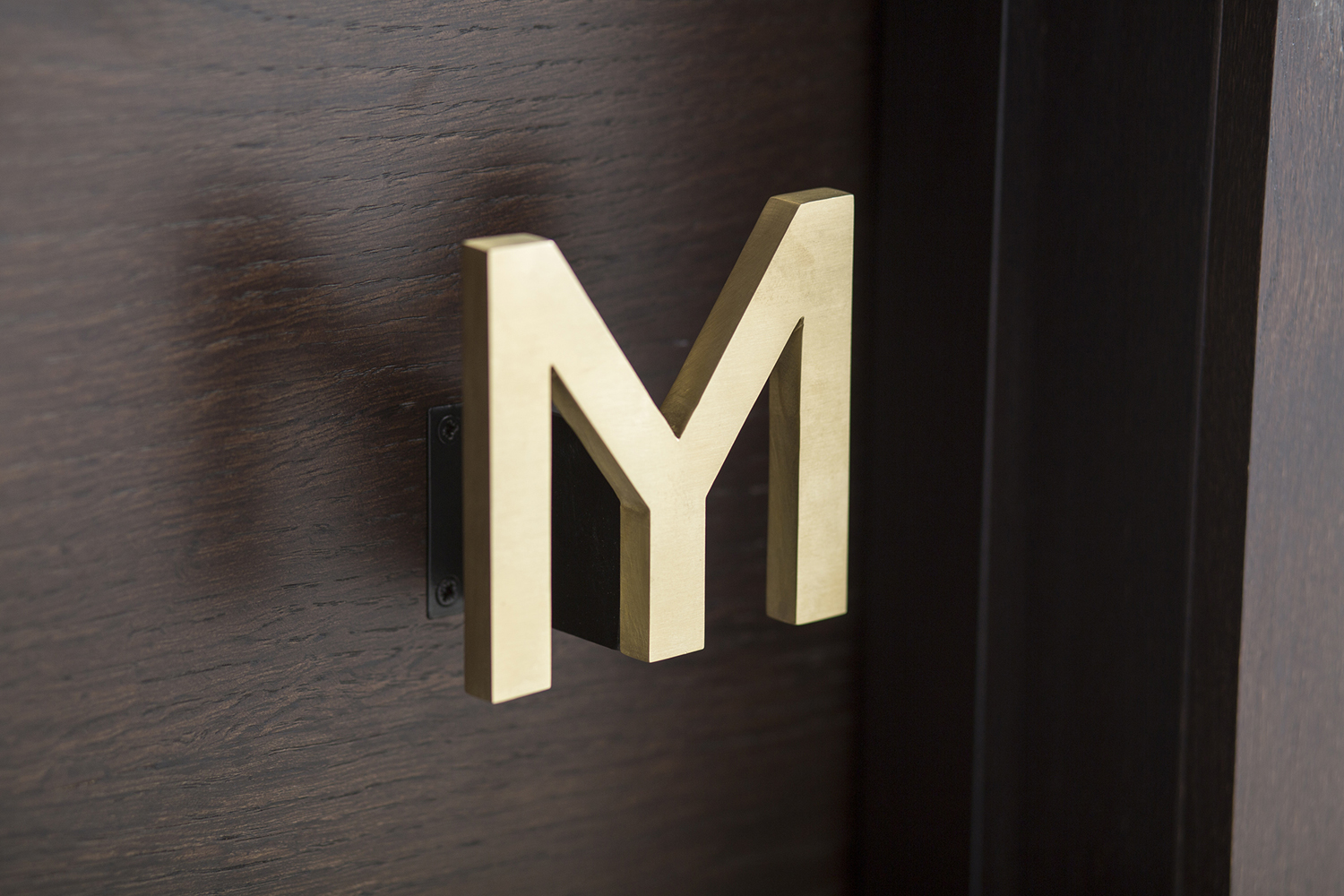 Logo as door handle designed by Bibliothèque for Monica Galetti's new London restaurant Mere