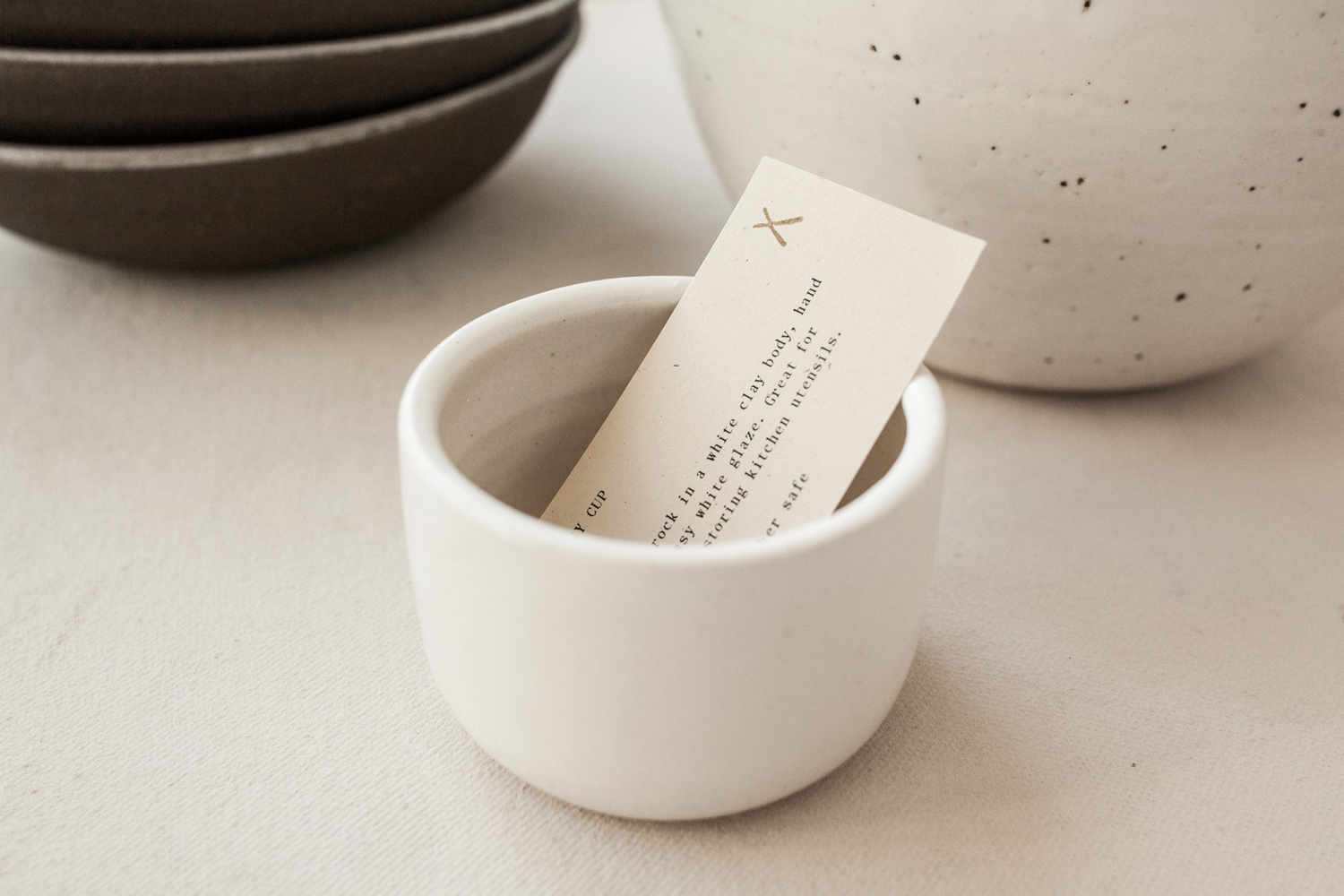 Brand identity and product card by Seattle-based design studio Shore for Natasha Alphonse Ceramics
