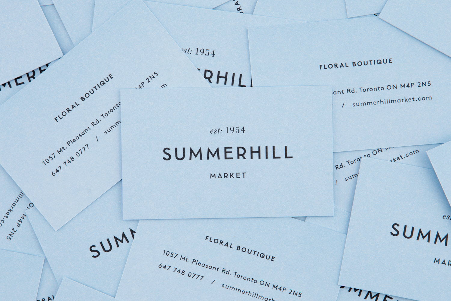 Brand identity and business cards designed by Canadian studio Blok for Toronto based boutique grocery store Summerhill Market