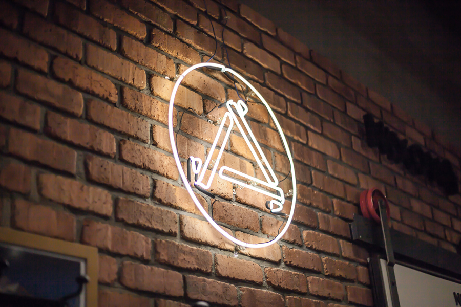 Logo and neon sign by Bravo for Singapore based men's retail store and coffee shop The Assembly