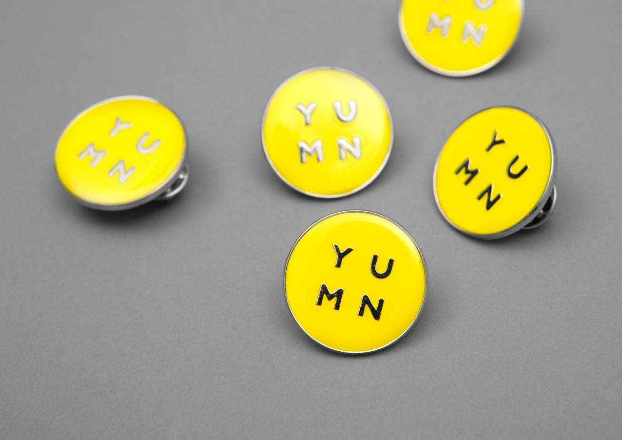 Logo pin badges by Brighton-based Filthymedia for Boxpark Croydon's casual luxury restaurant Yumn