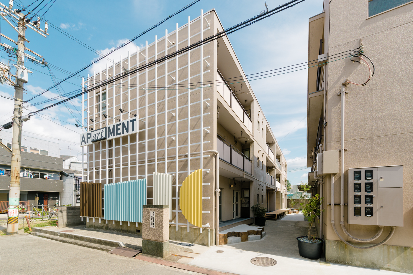 Wordmark, signage and facade by UMA for property development APartMENT in the new creative hub of Osaka's Kitakagaya area