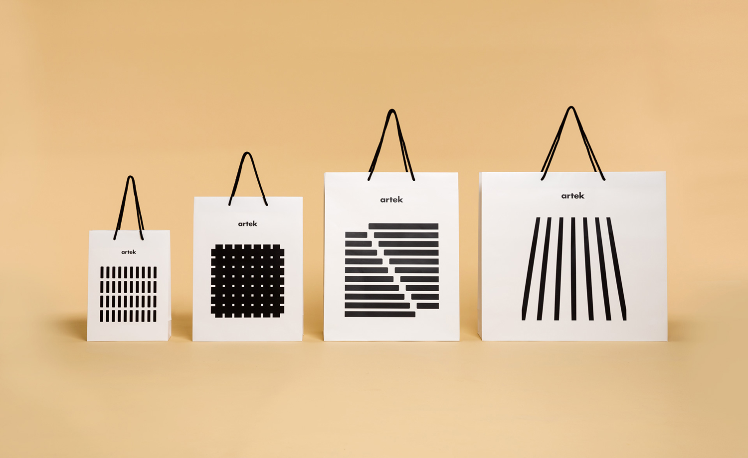 Brand identity and shopping bags by graphic design studio Tsto for furniture and homeware store Artek Helsinki.