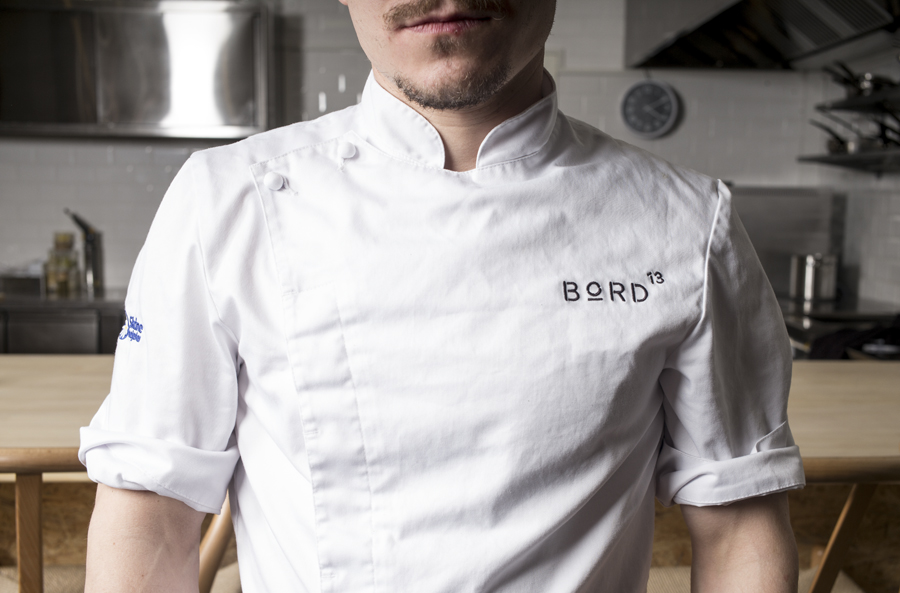 Branded chef whites for Malmö restaurant Bord 13 by Swedish graphic design studio Snask.