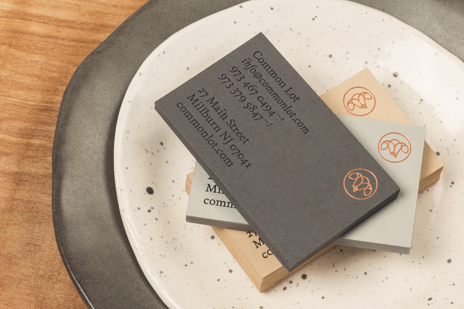 Business cards with copper block foil detail for restaurant Common Lot by Perky Bros, United States