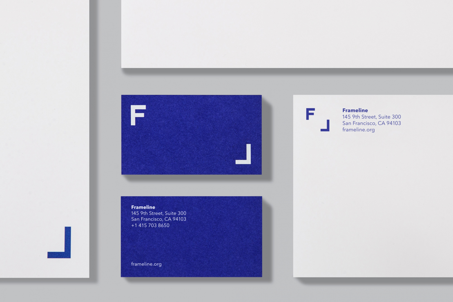 Business cards for LGBT film festival and non profit Frameline by Mucho. These feature a bright blue spot colour.