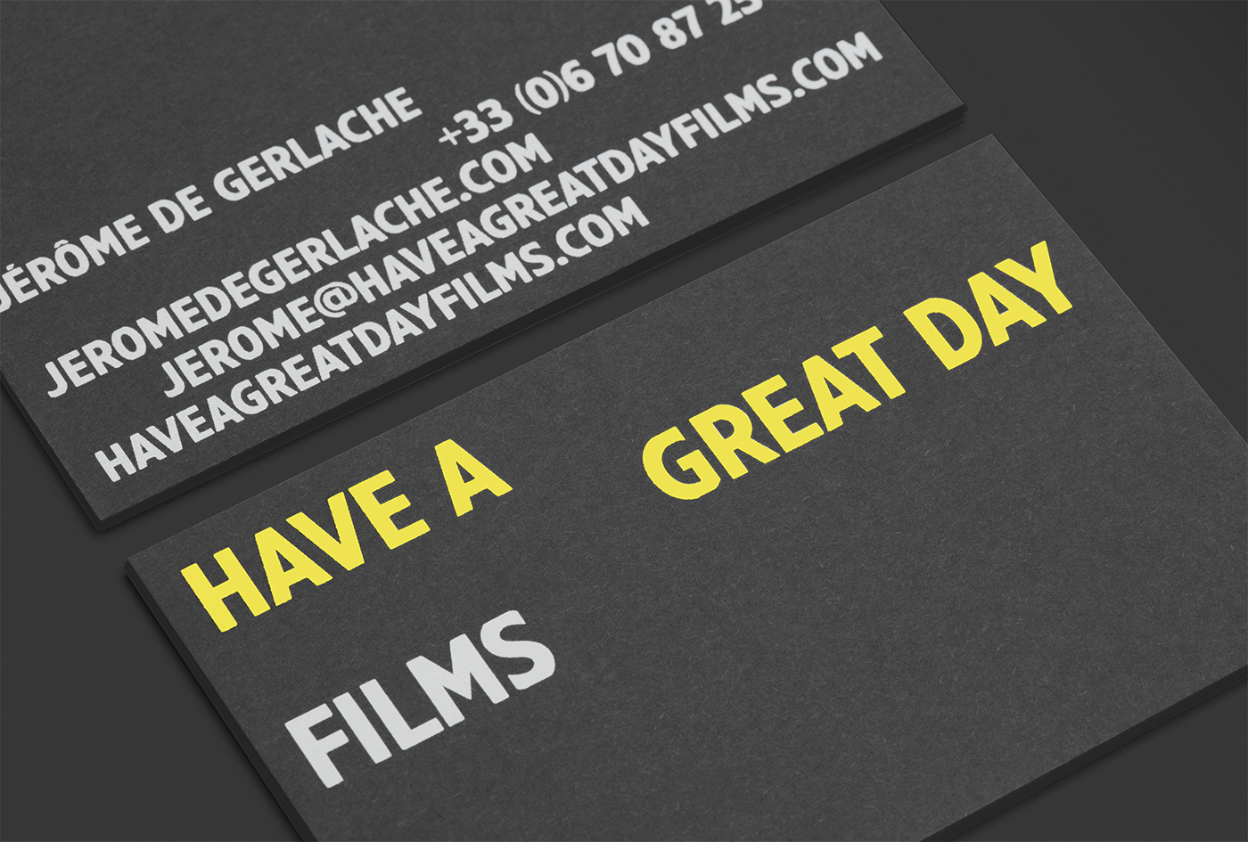 Black card and yellow and white foiled business cards for Have A Great Day Films designed by Hey