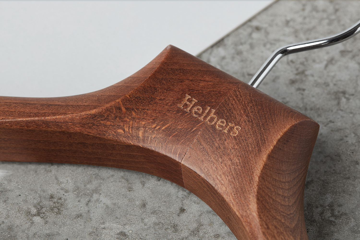 Logotype and branded wooden coat hanger by Leeds-based graphic design studio Only for Parisian menswear label Helbers