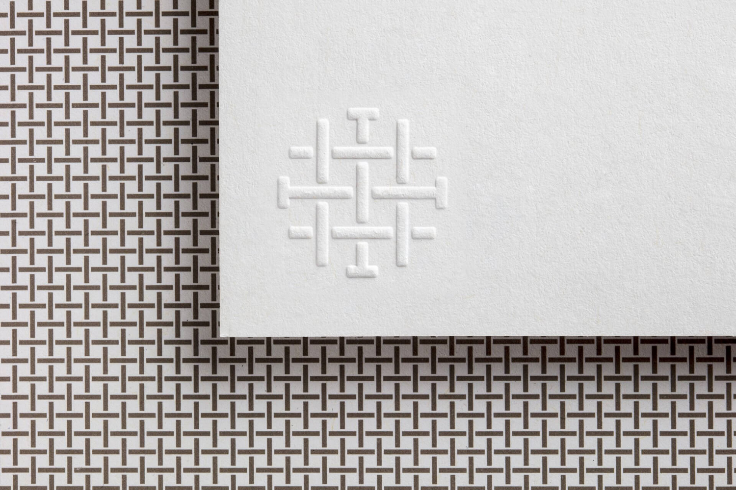 Brand identity and blind embossed business cards designed by Mucho for Spanish 5-star hotel Sant Francesc.