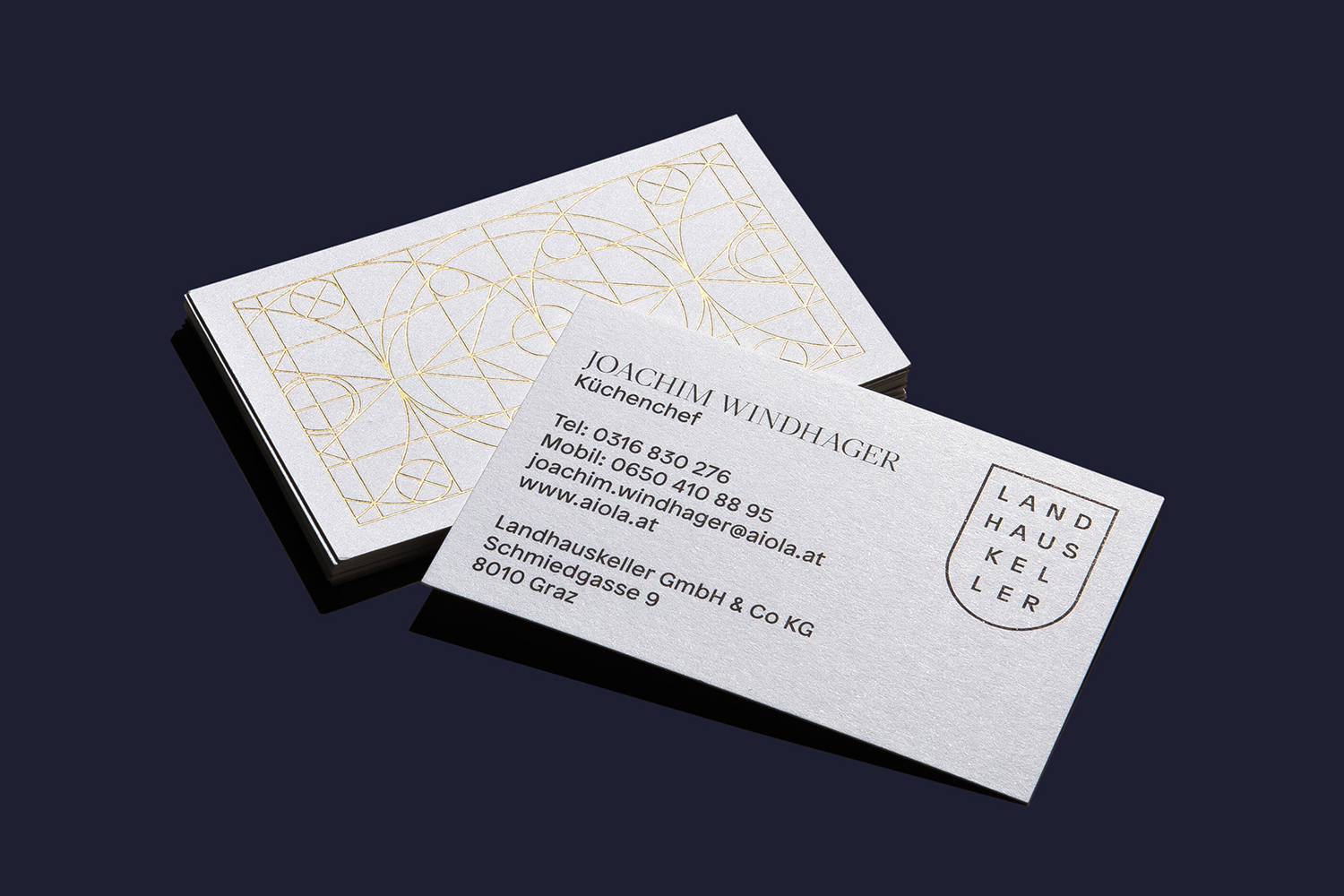 Brand identity and gold foiled business cards by Austrian graphic design studio Seite Zwei for Graz-based restaurant Landhaus Keller.