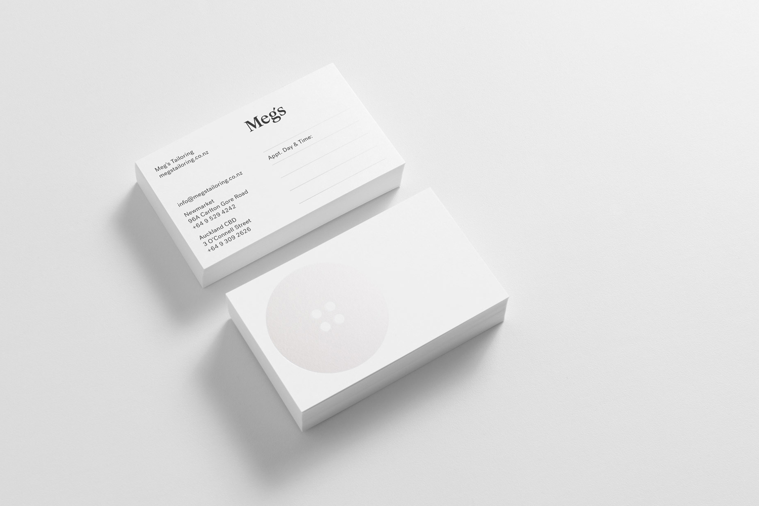 Brand identity and business cards by Auckland-based Studio South for New Zealand tailoring service Meg's