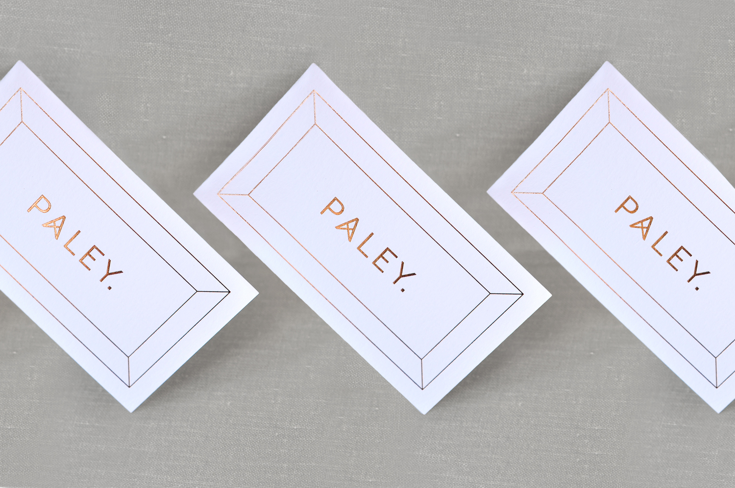Brand identity and copper block foiled business cards for Los Angeles restaurant Paley designed by Mucca, United States