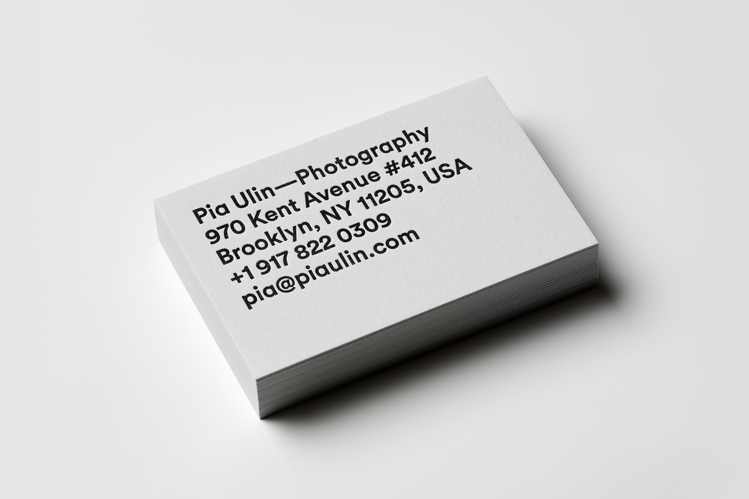 Grey board and black block foiled business card for Pia Ulin Photography designed by The Studio