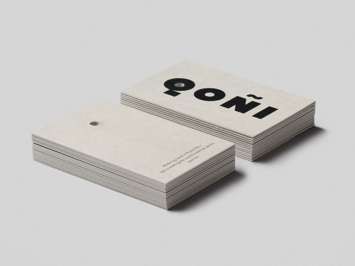 Logotype and uncoated and unbleached products tags by Toronto-based Leo Burnett Design for Peruvian handmade knitwear brand Qoñi