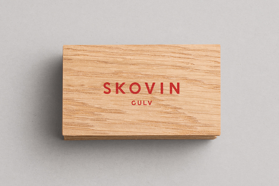 Logotype and wood veneer business card designed by Heydays for Norwegian high-end wood flooring specialist Skovin