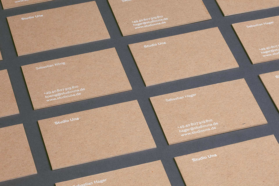 Kraft paper business cards with white ink print finish by German graphic design business Studio Una