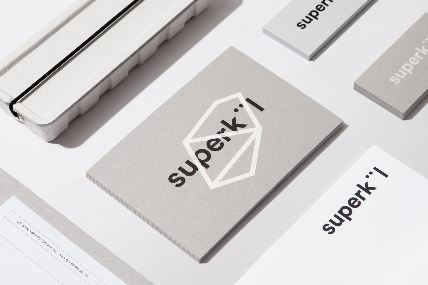 Brand identity and note card by Toronto-based graphic design studio Blok for Canadian architecture firm Superkül